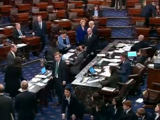 PHOTO: An image made from video shows politicians and staff on the floor of the U.S. Senate and the vote tally for terminating President Donald Trumps border emergency declaration, in Washington, March 14, 2019.
