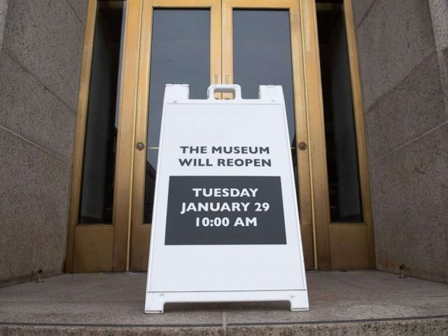 PHOTO: A sign stands at the entrance of the Smithsonian National Museum of Natural History stating they will reopen to the public following a 35-day partial government shutdown in Washington, D.C, Jan. 28, 2019.