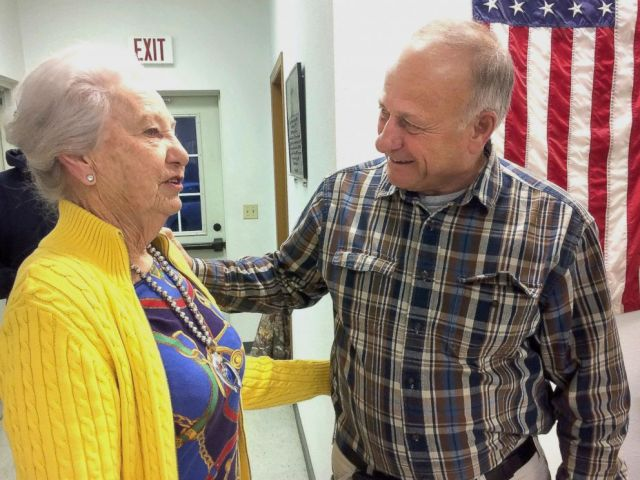 PHOTO: Precinct official Elaine Rex, of Odebolt, Iowa, talks with U.S. Rep. Steve King, of Kiron, Iowa, at the Odebolt Fire Station, where King cast the precincts first vote in the mid-term election in Odebolt on Tuesday, Nov. 6, 2018.