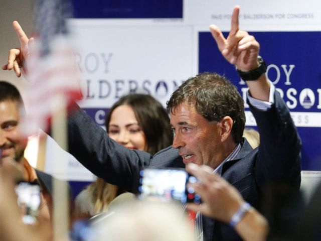 Troy Balderson, Republican candidate for Ohios 12th Congressional District, greets a crowd of supporters during an election night party Tuesday, Aug. 7, 2018, in Newark, Ohio.