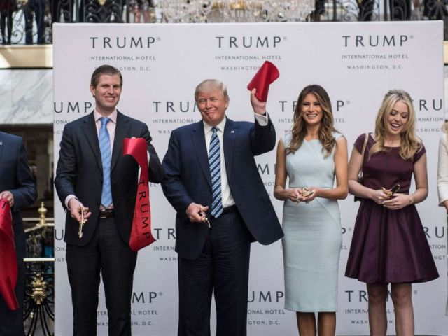 PHOTO: Donald Trump, accompanied by, from left, Donald Trump Jr., Eric Trump, Trump, Tiffany Trump, Melania Trump and Ivanka Trump, holds up a ribbon during the grand opening ceremony of the Trump International Hotel in Washington, Oct. 26, 2016.