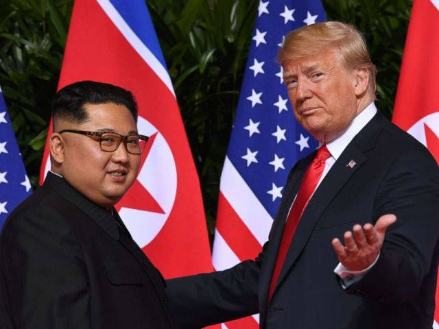 PHOTO: President Donald Trump gestures as he meets with North Koreas leader Kim Jong Un at the start of their historic US-North Korea summit, at the Capella Hotel on Sentosa island in Singapore, June 11, 2018.
