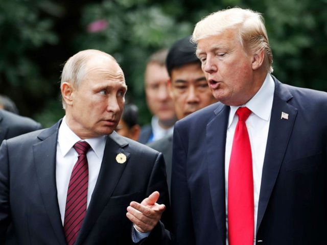 PHOTO: US President Donald Trump (R) and Russias President Vladimir Putin talk as they make their way to take the family photo during the Asia-Pacific Economic Cooperation (APEC) leaders summit in the central Vietnamese city of Danang.