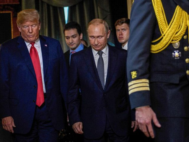 PHOTO: President Donald Trump and Russias President Vladimir Putin arrive for a meeting at Finlands Presidential Palace on July 16, 2018 in Helsinki.