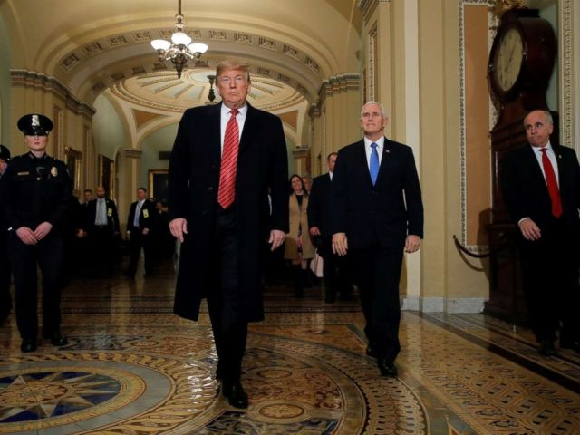 PHOTO: President Donald Trump is accompanied by Vice President Mike Pence as they arrives to attend a closed Senate Republican policy lunch as a partial government shutdown entered its 19th day on Capitol Hill in Washington, Jan. 9, 2019.