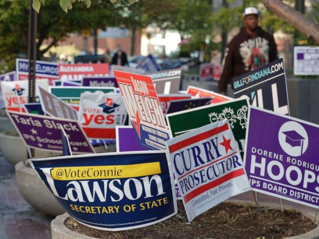 PHOTO: Signs for candidates in the upcoming Nov. 6 election fill flower beds outside an early voting center at the City County Building in Indianapolis, Oct. 23, 2018.