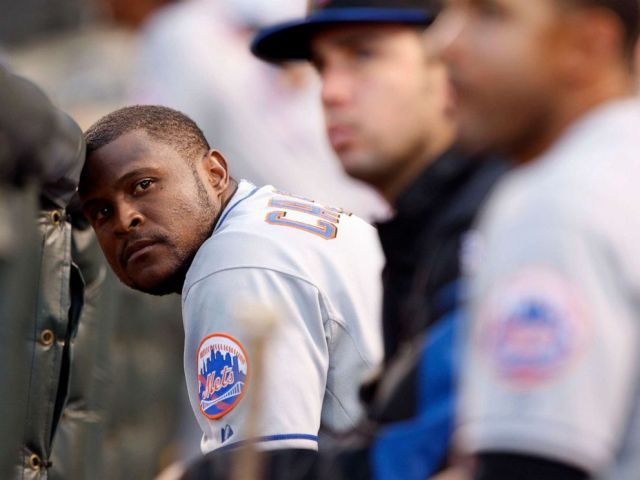 PHOTO: In this June 21, 2008 file photo, New York Mets second baseman Luis Castillo rests his head against the dugout rail in the eighth inning of the Colorado Rockies 7-1 victory over the Mets in a Major League baseball game in Denver.