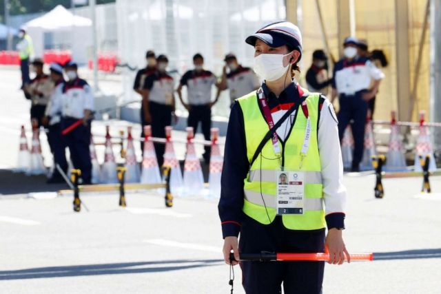 PHOTO: Security staff stands guard at the entrance of the Athletes Village, where a person has tested positive for COVID-19, ahead of Tokyo 2020 Olympic Games in Tokyo, Japan July 17,  2021.
