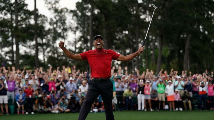 Tiger Woods reacts as he wins the Masters golf tournament, April 14, 2019, in Augusta, Ga.
