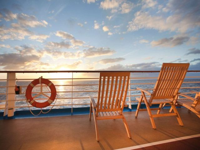 PHOTO: Deck chairs and a life saver ring are pictured on a cruise ship deck in this undated stock photo.