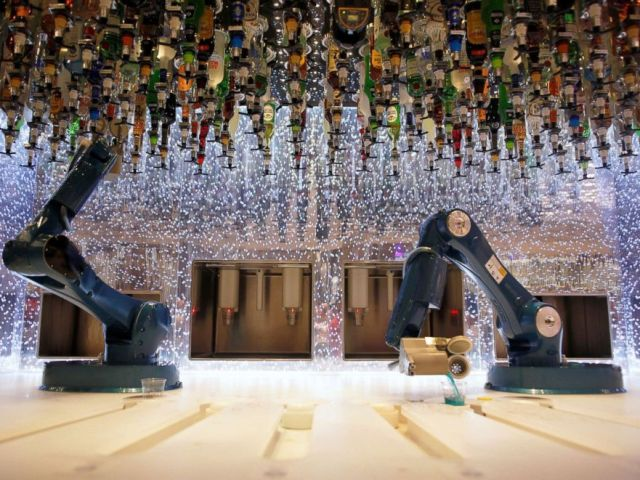 PHOTO: Robots serve drinks at the bionic bar on the worlds largest cruise ship of Royal Caribbean Cruises during its world presentation ceremony at a port in Malaga, Spain, March 27, 2018.