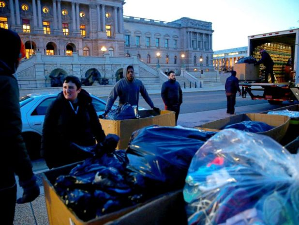 PHOTO: Activists with AVAAZ unloading 7000 shoes in the early morning hours on Capitol Hill in Washington, DC, March 13, 2018. The shoes were laid out on the lawn at the Capitol as a symbol to the number of lives lost to gun violence since Newtown, CT.