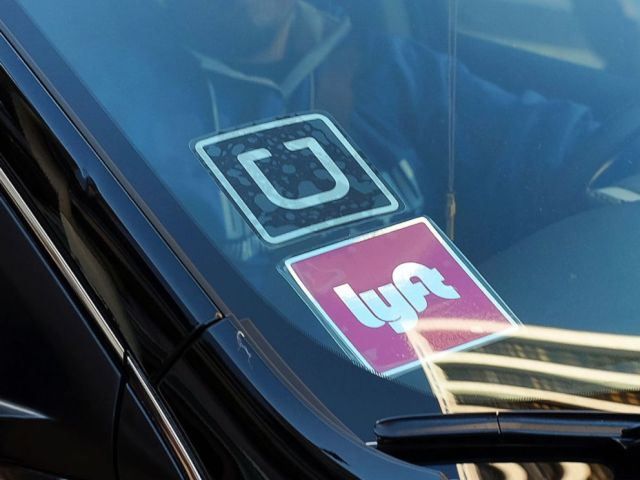 PHOTO: A driver displaying Lyft and Uber stickers on his front windshield, in Los Angeles, Jan. 12, 2016.
