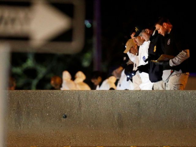 PHOTO: Police collect evidence after the bombing suspect blew himself up after being confronted by police in Round Rock, Texas, March 21, 2018.