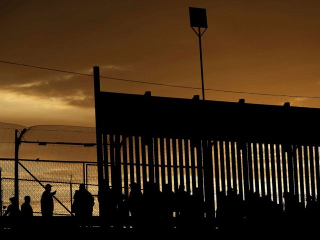 PHOTO: Migrants listen to U.S. Customs and Border Protection officials after crossing illegally into the United States to request asylum in El Paso, Texas, April 5, 2019.