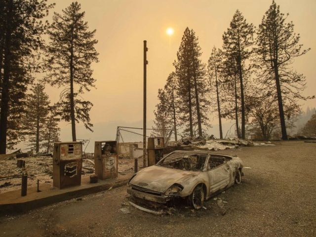 PHOTO: As the Camp Fire burns nearby, a scorched car rests by gas pumps near Pulga, Calif., Nov. 11, 2018.