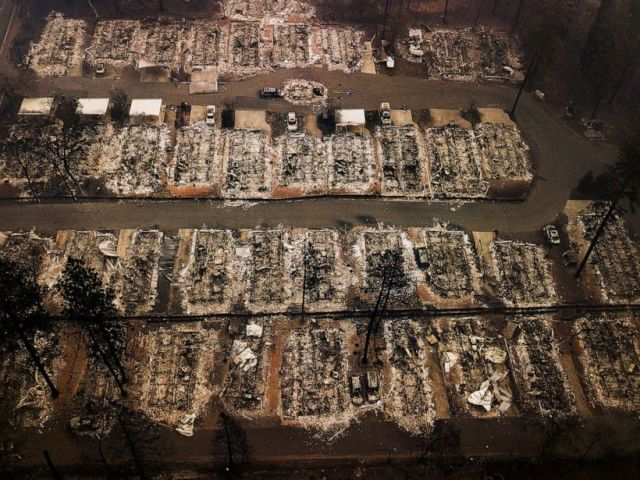 PHOTO: This Nov. 15, 2018, aerial file photo shows the remains of residences leveled by the Camp wildfire in Paradise, Calif.