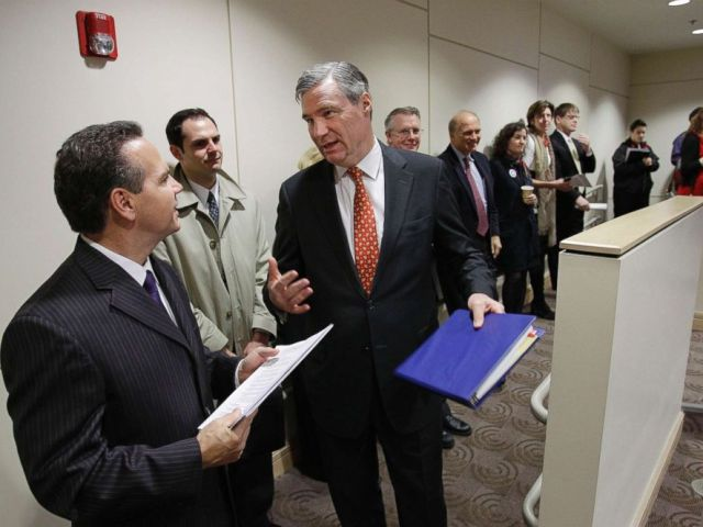 PHOTO: Sen. Sheldon Whitehouse, D-R.I., talks with Providence Mayor and Rep.-elect David Cicilline, D-R.I., left, during the Ocean State Consortium of Advanced Resources (OSCAR) conference at Brown University in Providence, R.I., Dec. 13, 2010.