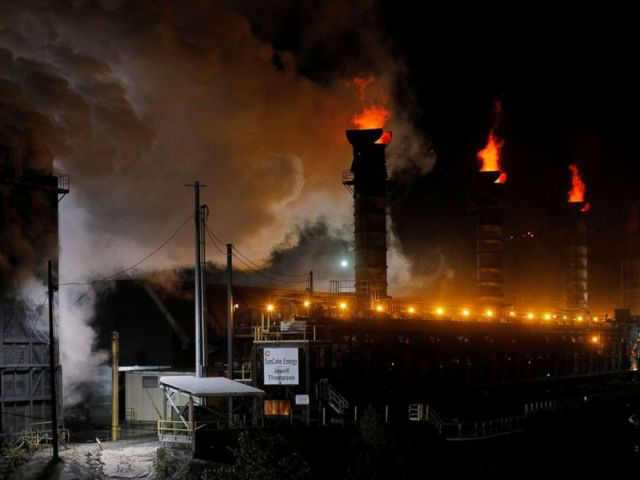 PHOTO: Flames, steam and exhaust rise from the Suncoke Jewell coke making plant, which burns coal to make coke which is used to make steel, in Oakwood, Va., May 19, 2018.