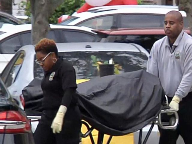 PHOTO: A body is removed from the scene in Miami-Dade County where a Coast Guard serviceman allegedly shot and killed his wife and son before killing himself, Dec. 16, 2018. His 8-year-old daughter was also critically wounded in the shooting.