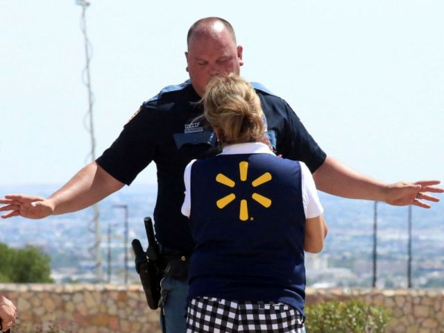 PHOTO: An El Paso police officer talks to a store employee following a shooting at a shopping mall in El Paso, Texas, on Aug. 3, 2019.