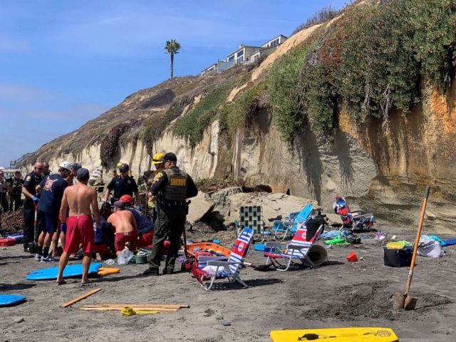 PHOTO: Emergency responders attend to a cliff collapse that has trapped people at a beach in Encinitas, Calif., on Friday, Aug. 2, 2019.