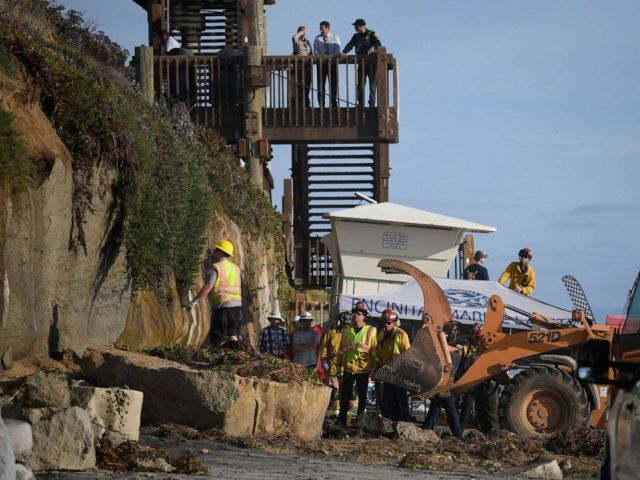 PHOTO: Search and rescue personnel work at the site of a cliff collapse at a popular beach Friday, Aug. 2, 2019, in Encinitas, Calif.