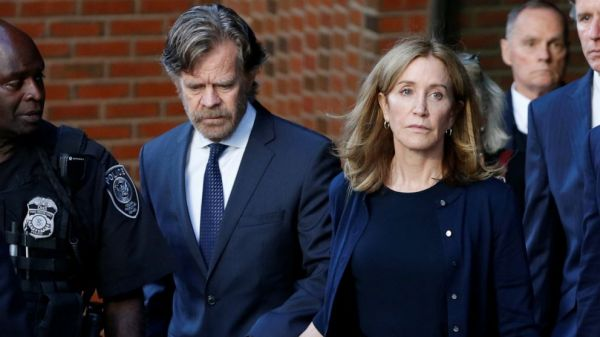 Actress Felicity Huffman reports to prison to serve sentence in college entrance scam
