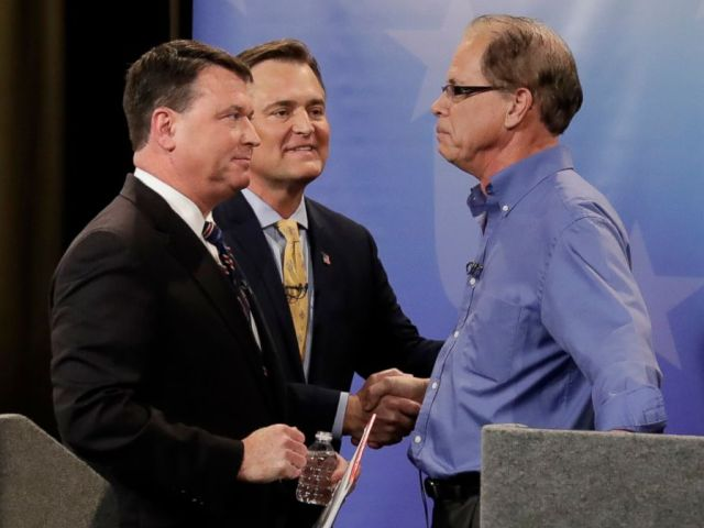 PHOTO: Candidates from left, Todd Rokita, Luke Messer and Mike Braun speak with each other following the Indiana Republican senate primary debate in Indianapolis, April 30, 2018.