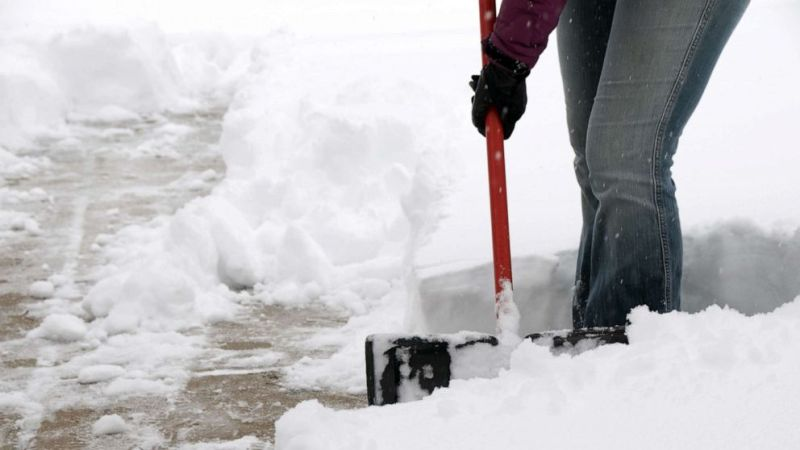 PHOTO: A person shovels snow.