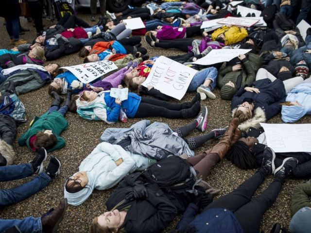 PHOTO: Demonstrators lie on the ground during a lie-in demonstration supporting gun control reform near the White House on Feb. 19, 2018.