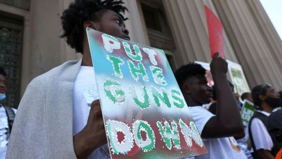 """PHOTO: NEW YORK, NEW YORK - JULY 19: People gather at the """"Stand Up Against Gun Violence"""" rally at Bronx Borough Hall on July 19, 2021 in South Bronx in New York City."""