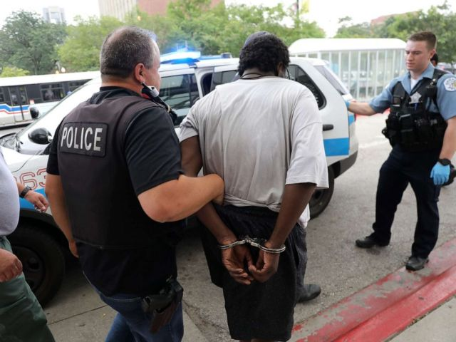 PHOTO: A man is detained by police outside of Jesse Brown VA Medical Center after reports of possible shots fired inside the hospital, Aug. 12, 2019 in Chicago.