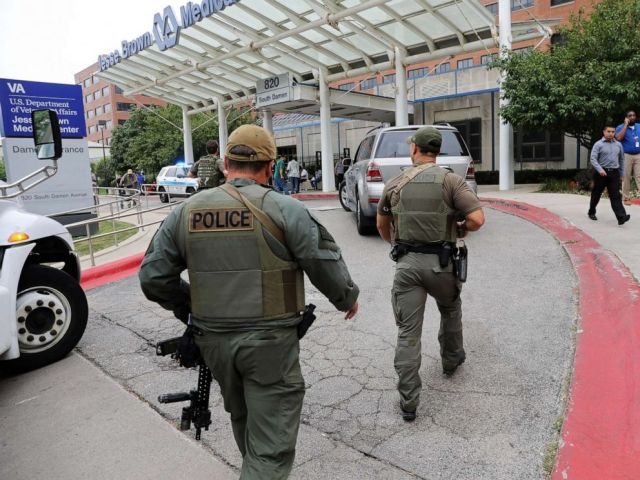 PHOTO: Police officers enter Jesse Brown VA Medical Center after reports of possible shots fired inside the hospital, Aug. 12, 2019 in Chicago.