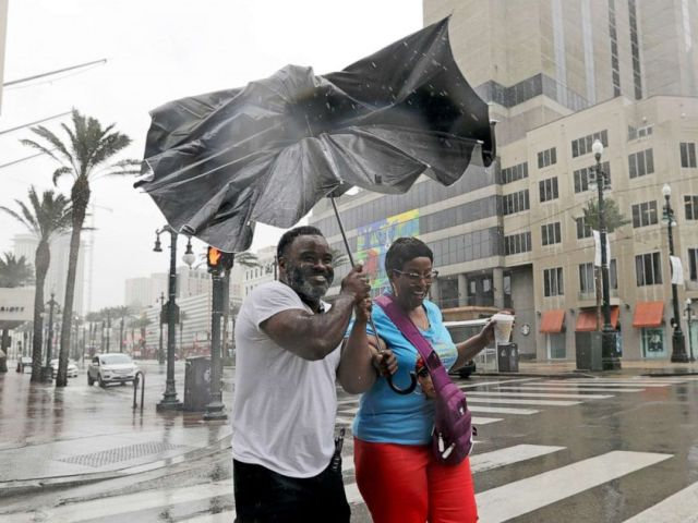 PHOTO: People battle the wind and rain from Hurricane Barry as it nears landfall in New Orleans, July 13, 2019.
