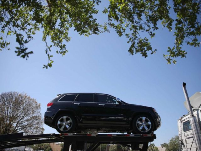 PHOTO: A 2014 Jeep Cherokee is seen on a transport truck on April 2, 2014 in Miami.