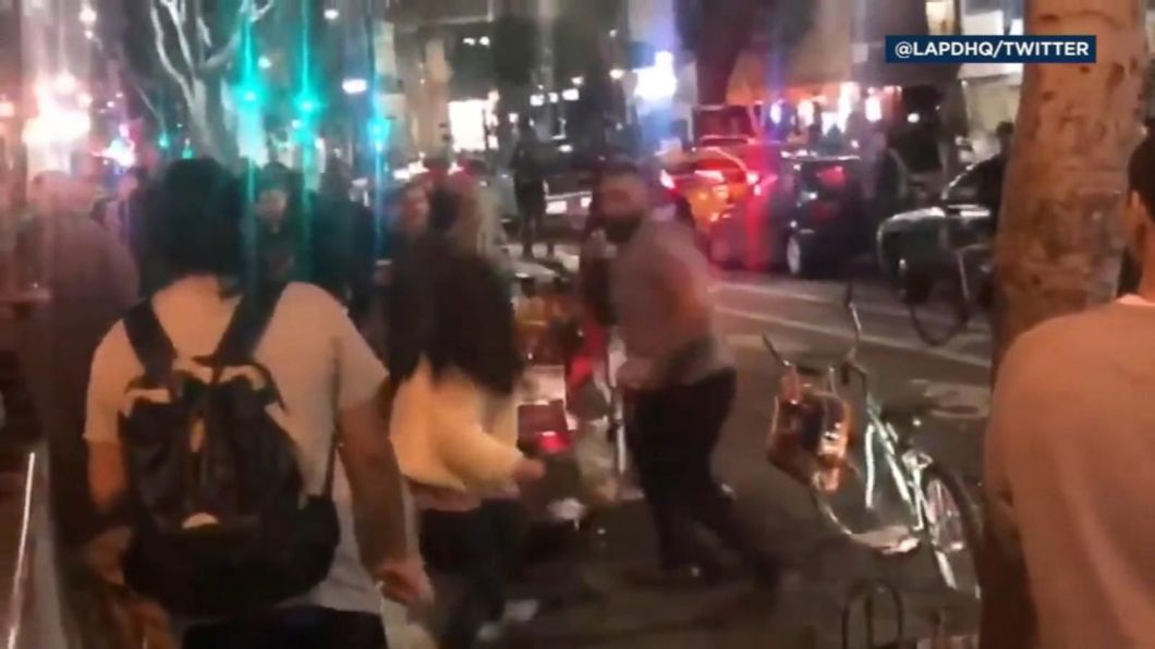 Image result for man punch 2 women hot dog stand la