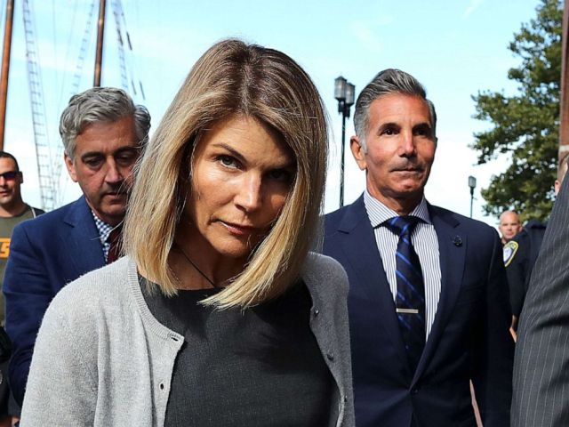 PHOTO: BLori Loughlin and her husband Mossimo Giannulli, right, leave the John Joseph Moakley Courthouse in Boston, Aug. 27, 2019.