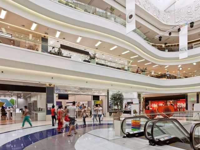 PHOTO: Shoppers are pictured a a mall (shopping center)