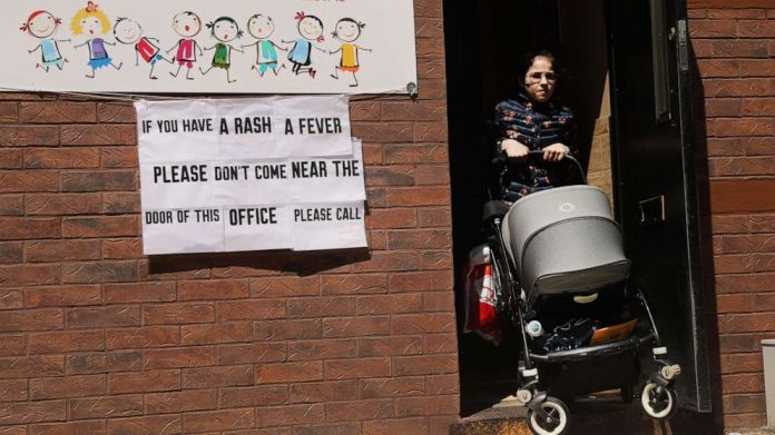 In the ultra-Orthodox Jewish community in Williamsburg on April 10, 2019 in New York, a sign warns people against measles.