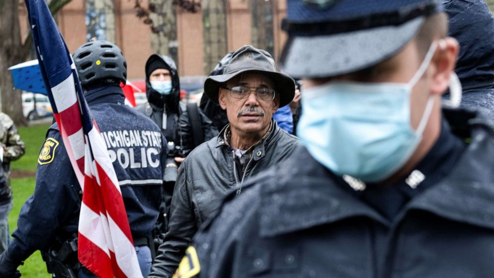 Protester with ax involved in clash at Michigan rally against stay-at-home orders thumbnail