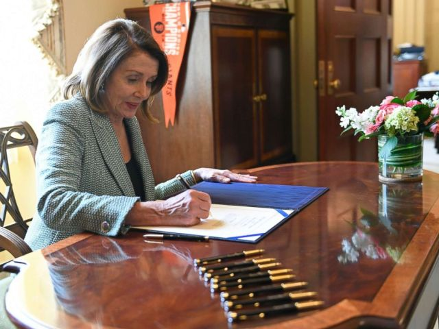 PHOTO: House Speaker Nancy Pelosi of Calif., signs H.J. Res 46, a disapproval resolution that blocks President Trumps national emergency declaration, on Capitol Hill in Washington, March 14, 2019.
