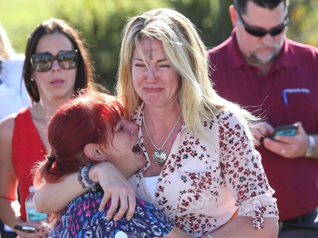 PHOTO: Women embrace in a waiting area for parents of students after a shooting at Marjory Stoneman Douglas High School in Parkland, Fla., Feb. 14, 2018.