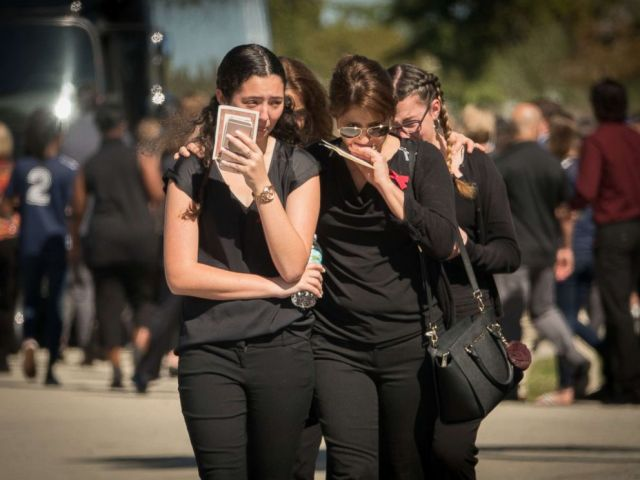 PHOTO: Family and friends cry after attending the funeral service for Alyssa Miriam Alladeff, 14, a victim of the school massacre at Marjory Stoneman Douglas High School in Parkland, Fla., Feb. 16, 2018.