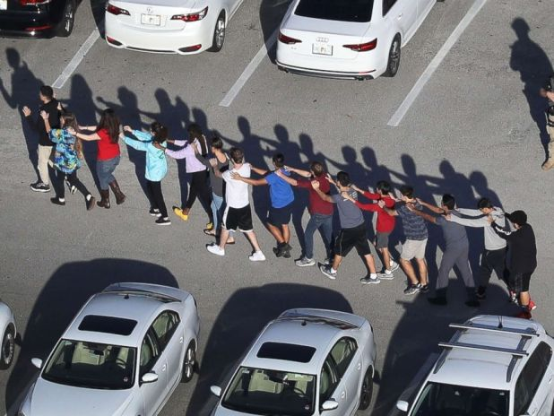PHOTO: Students are brought out of the Marjory Stoneman Douglas High School after a shooting at the school that reportedly killed and injured multiple people on Feb. 14, 2018 in Parkland, Florida.