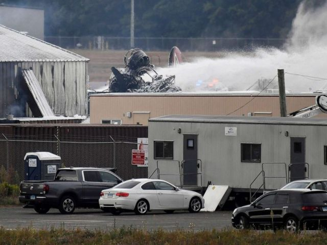 PHOTO: A fire-and-rescue operation is underway where World War II-era bomber plane crashed at Bradley International Airport in Windsor Locks, Conn., Wednesday, Oct. 2, 2019.