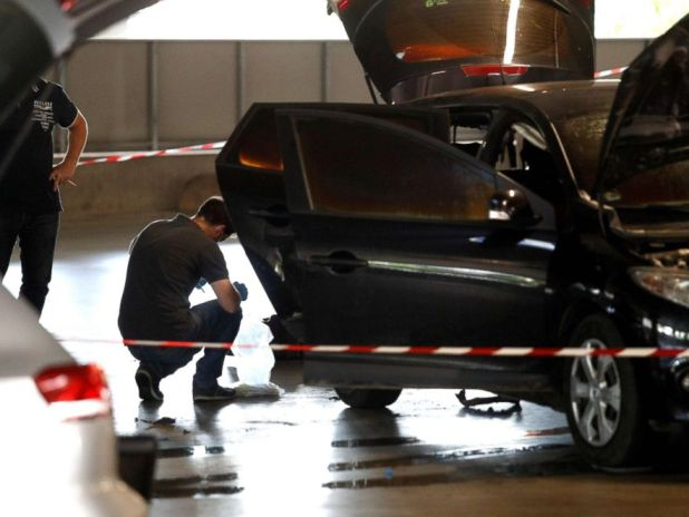 PHOTO: This photo taken on July 1, 2018 in Aulnay-sous-Bois shows a forensic police investigating an abandoned car by French armed robber Redoine Faid in the parking lot of the OParinor shopping center after his escape on board. a helicopter from a prison.
