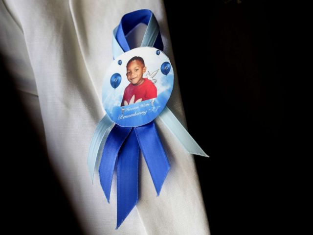 PHOTO: In this Tuesday, Aug. 14, 2018 photo taken in Houston, a pin on the lapel of Dikeisha Whitlock-Pryers jacket shows a photo of her son, Raymond Pryer Jr.
