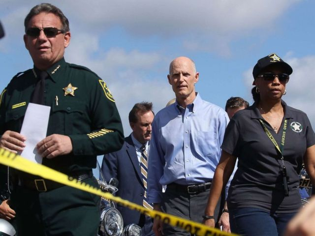 PHOTO: Florida Governor Rick Scott,(C) walks to the media to speak about the mass shooting at Marjory Stoneman Douglas High School where 17 people were killed yesterday, on Feb. 15, 2018, in Parkland, Fla.