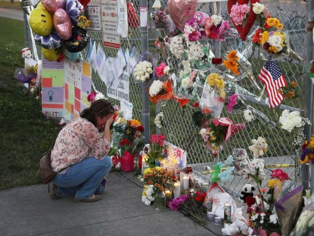 PHOTO: Melissa Goldsmith visits a makeshift memorial setup in front of Marjory Stoneman Douglas High School on Feb. 18, 2018, in Parkland, Fla.
